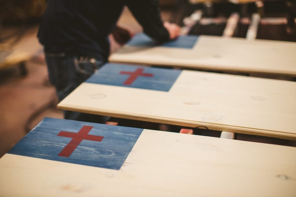 Image of Christian Flag moving through handcrafted production at FOV with The Greater Glory Company