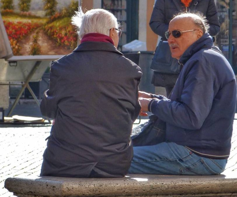 image of two men talking on bench encouraging one another