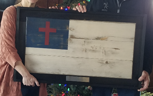 The Collective of The Cross Flag Arrives